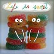 Candy with eyes, mouth, and arms and words Life is Sweet