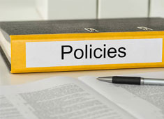 Notebook labeled Policy